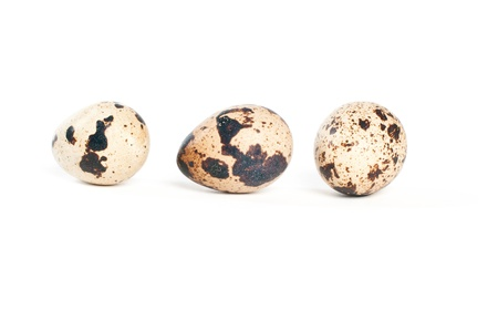 Quail eggs on white background. photo