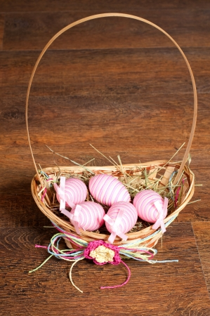 Basket with ornamental eggs for background boards. photo