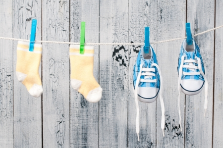 Baby clothes hanging on the clothesline. photo