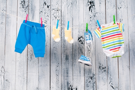 Baby clothes hanging on the clothesline. Stock Photo - 19055754