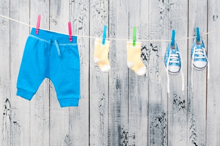brown clothes: Baby clothes hanging on the clothesline  Stock Photo