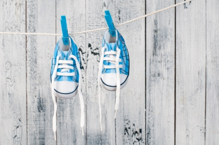 Baby shoes hanging on the clothesline Stock Photo - 19098111