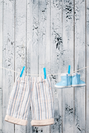 sully: Baby clothes hanging on the clothesline  Stock Photo