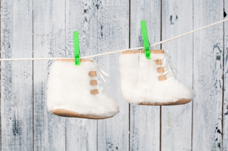 Children s boots hanging on a clothesline  photo