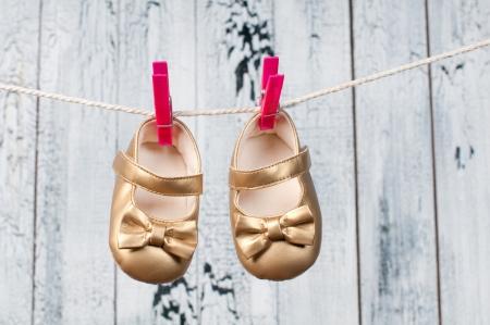 Children s sandals hanging on a clothesline