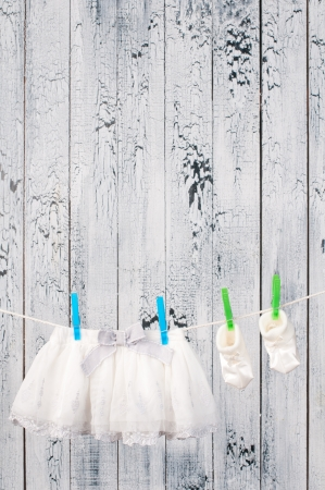Baby clothes hanging on the clothesline  photo