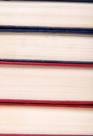 hardcover: Multicolored books stack isolated on white background