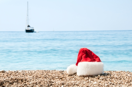Christmas hat lies on the beach.