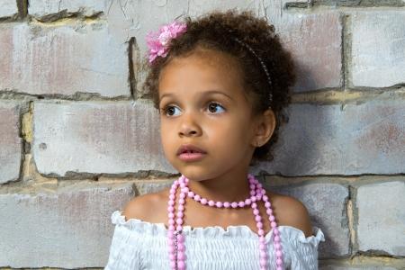 mulatto: Portrait of a little girl mulatto, it is sad.