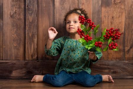mulatto: Mulatto girl with berries in her hands.