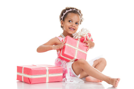 mulatto: Little surprised mulatto girl with gifts.