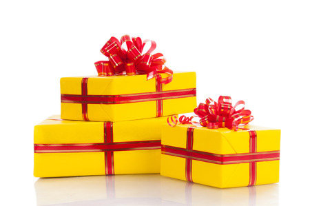 Three yellow gift on a white .