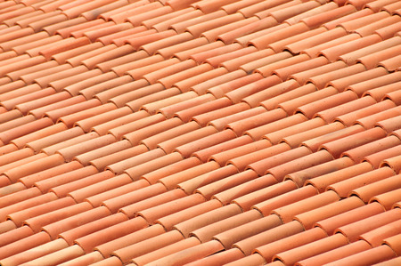 Old red tiles roof background photo