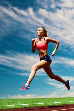 scamper: Sport running girl on the background of stadium and sky