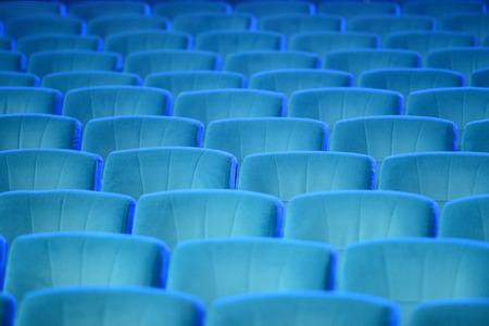Empty comfortable green seats in theater, cinema photo