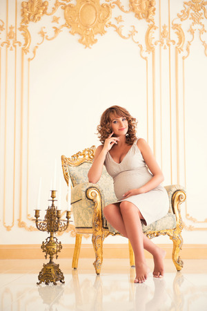 Fashionable pregnancy. Future beautiful mother in an expensive interior Stock fotó