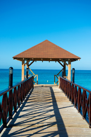 pontoon: Wooden pontoon. Dock with canopy stretching into the sea