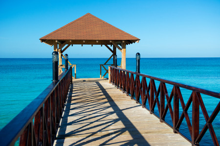 guard rail: Wooden pontoon with canopy and with fence stretching into the sea