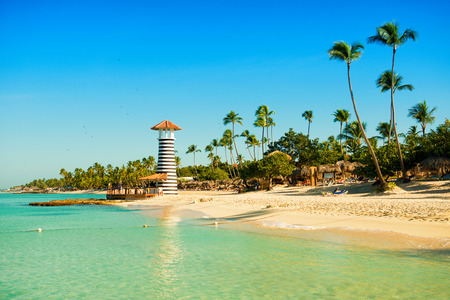 pharos: Paradise tropical island in Dominican Republic. White sand, blue sea, clear sky and  lighthouse on shore