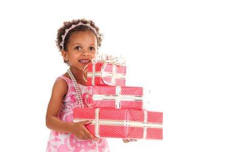 mulatto: Cheerful  smiling mulatto girl give gift boxes in hands on a white background. Birthday present
