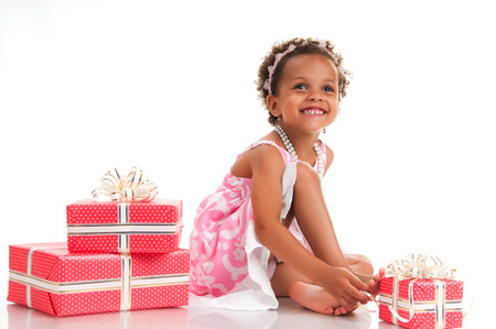 mulatto: Smiling mulatto girl with pink gift box. Birthday present. Shopping. Prize, win, event.