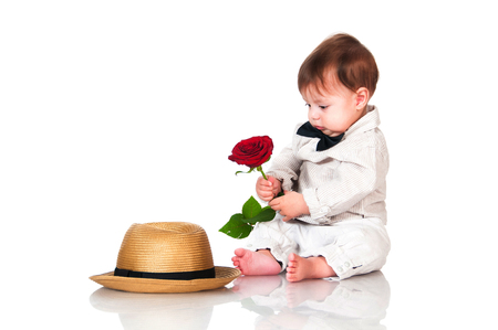 one year: Little one old year  boy with  hat and red rose sitting on white background. Retro, vintage Stock Photo