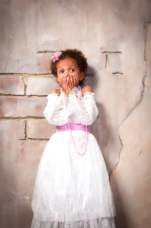 actress girl: Little actress. Beautiful african  girl shows emotions: fear, fright, surprise Stock Photo