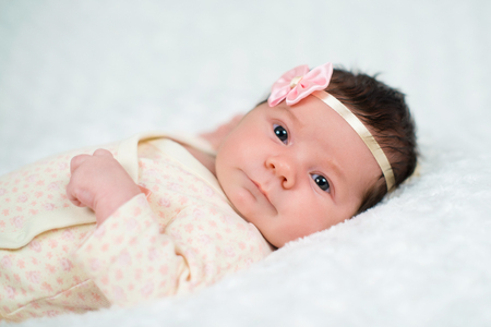 pink bow: Cute newborn baby girl with pink bow Stock Photo