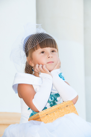 and magnificent: Portrait of a cute little girl in a magnificent white and blue dress