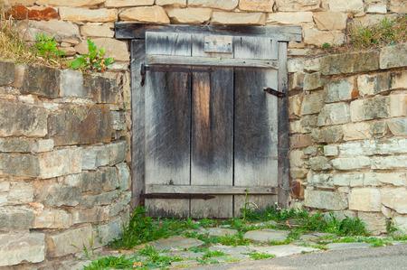 pirogovo: Ancient Wooden doors and stone wall. Ukraine, Pirogovo museum