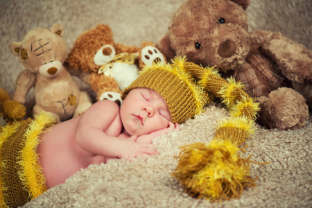 pale color: Little baby boy, sleeping. Newborn baby sleeping on toys background Stock Photo
