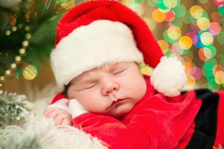 3d9e89703 Portrait Of Newborn Baby Boy In Santa Clothes Lying Under Christmas ...