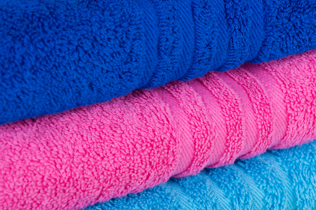 convolute: Stack of beautiful colored bath towels pink, blue