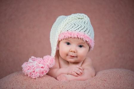 bringing: Newborn baby in a warm knitted hat.