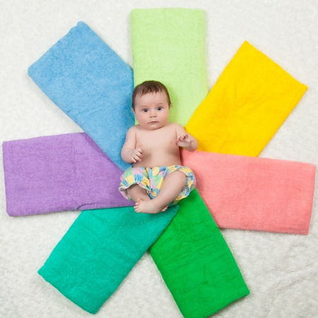nude little girls: Newborn baby lying on a stack of towels