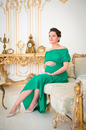 Fashionable pregnancy. Future mother in an expensive interior Stock fotó