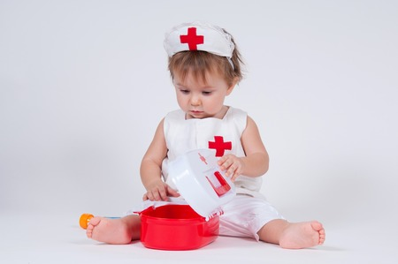 child playing as a doctor with syringe Stock Photo