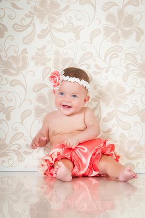 Fashionable smiling baby girl in pink panties