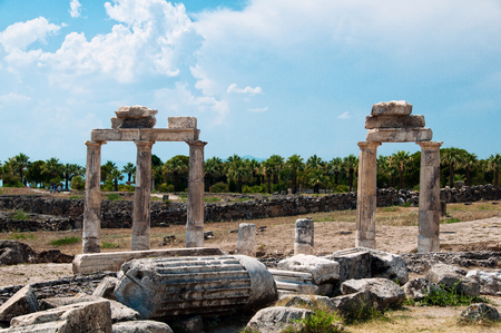 Ruins and old buildings in Hierapolis ancient city adjacent to modern Pamukkale in Turkey