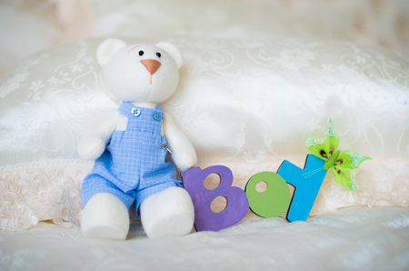 Purple knitted baby socks with an inscription of a child and a toy hare
