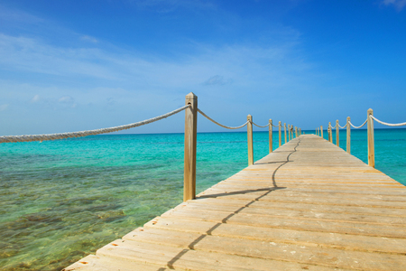 Wooden bridge over the sea. Travel and Vacation. Freedom Concept.
