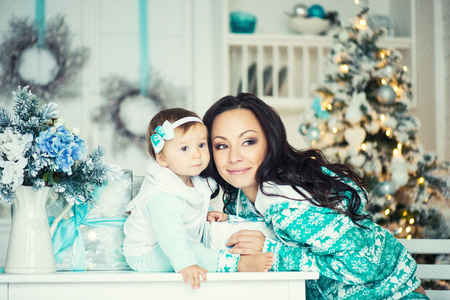 Mom and daughter in the Christmas mood.