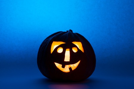 Halloween pumpkin with scary face on black backgound Stock Photo