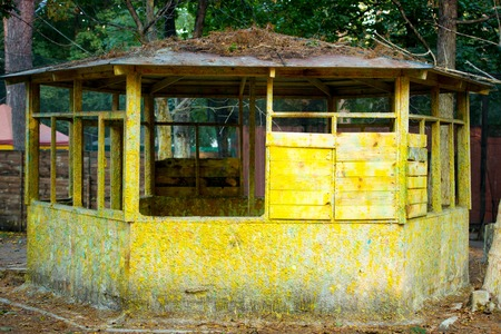 Old wooden ruined house is yellow. Rural abandoned hut. Abandoned house.