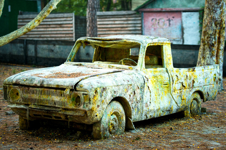 An old rusty car in paint from paintball