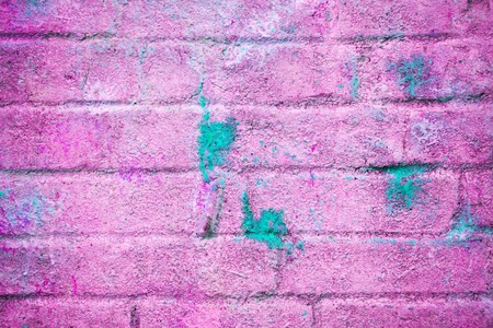 Background and wallpaper or texture pink brick wall with stains of blue paint Stock Photo