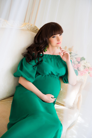Fashionable pregnancy. Future mother in an expensive interior 版權商用圖片