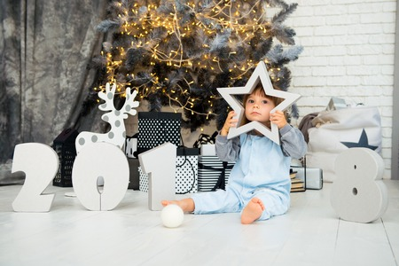 Happy little star. New Year 2018, Christmas. Smiling funny two year old baby girl. Stock Photo