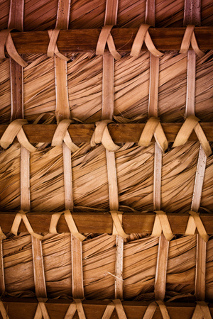 background of a brown thatched roof inside