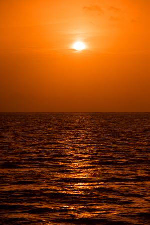 Setting sun on pacific ocean. Beautiful sunset, sunrise sea horizon.
